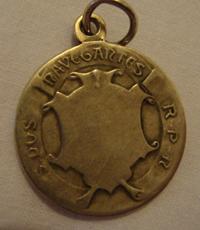 reverso de la Medalla besada por la Sma. Virgen